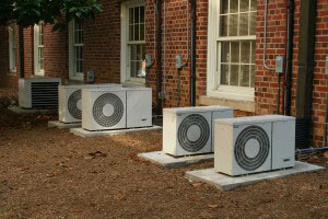air conditioners lined up outside of a building